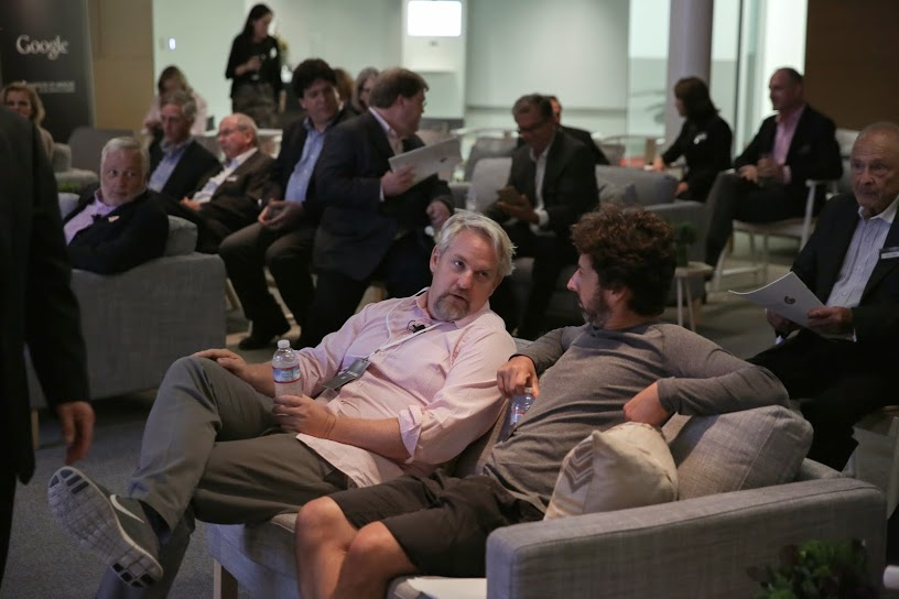 Sergey Brin, CEO of Google, and XXX chat during the Listening Tour event at Google's headquarters